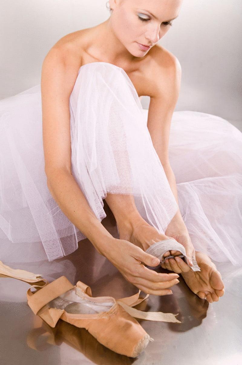 content ballerina sit down on floor to put on slippers prepare econet ru